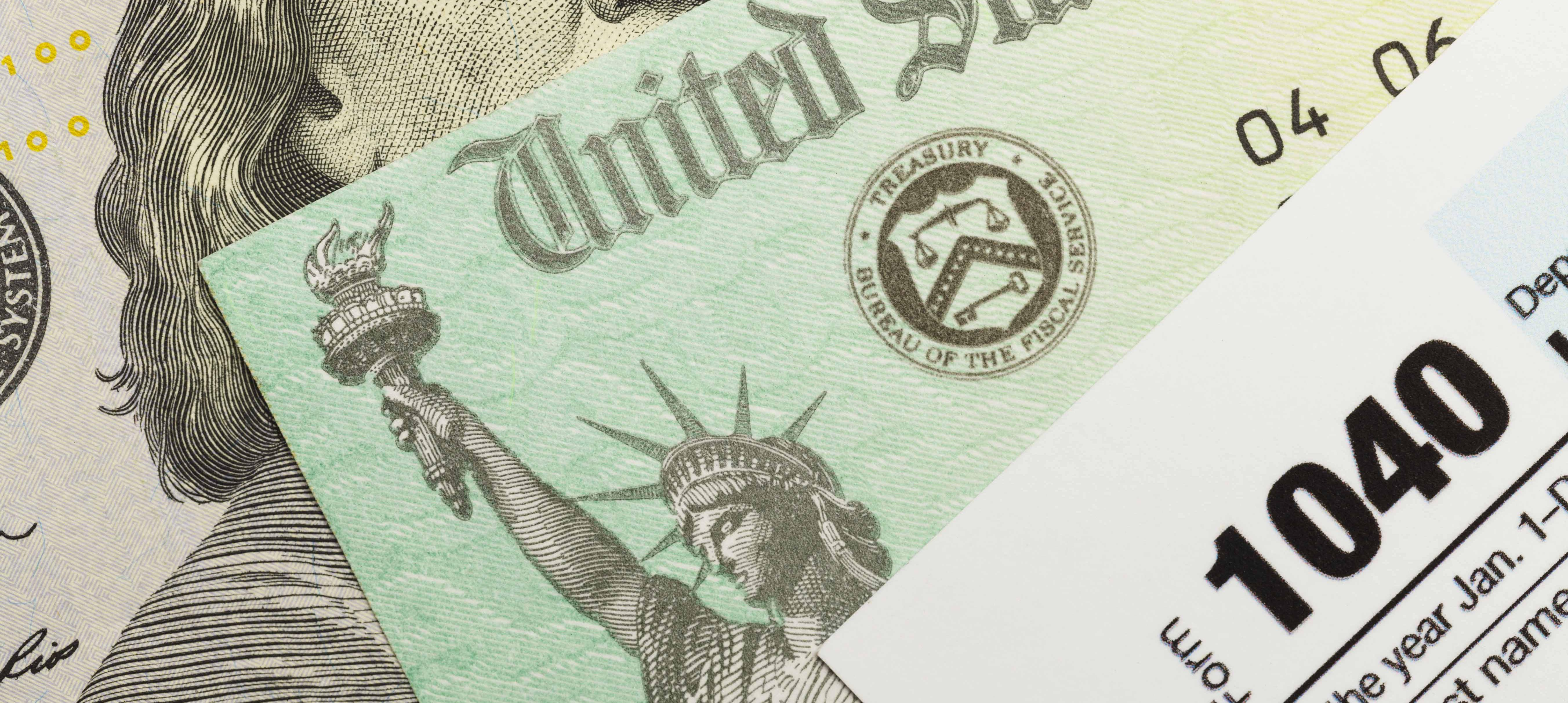 U.S. 1040 form against a backdrop of a U.S. Treasury Check